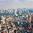 View to the skyline of Bangkok from a skyscraper - Stock Photo