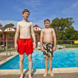 Stock Photo: Brothers having fun at the pool