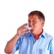 Thirsty man drinking out of a wine glass — Stock Photo #5798315