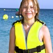 Girl with life vest at the beach — Stock Photo