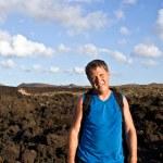 Man walking in lava field — Stock Photo