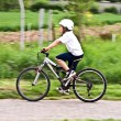 Young boy with helmet is riding mountain bike — Stock Photo #5799276