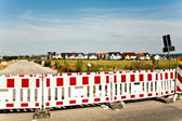 Hoarding in a housing area under construction — Stock Photo