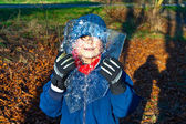 Boy with brown eyes is looking through an ice plate — Stock Photo