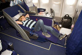 Boy relaxing in a business class seat — 图库照片