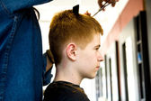 Smiling young boy with red hair at the hairdresser — Stock Photo