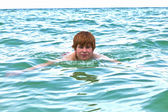 Child is swimming in the ocean — Stock Photo