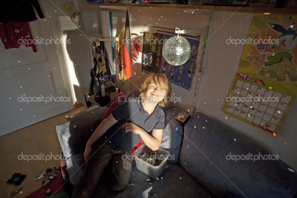 Boy with mirror ball in his nursery surrounded by his toys — Stock Photo #5797639