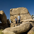Brothers on a rock at yoshua tree national park near park boulev — Stock Photo
