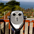 Binoculars at the golden gate bridge are formed like a face - Stock Photo