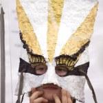 Boy under a hand made mask — Stock Photo #5803469
