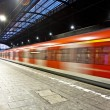 Train im motion enters the station — Stockfoto