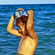 Stock Photo: Young boy with diving mask in the sea