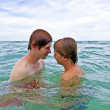Boys having fun in the clear sea — Stock Photo #5804781