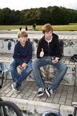 Cool boys sitting on a stone — Stock Photo