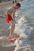 Boy learning surfing at the beach — Stock Photo