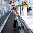 Boy in the departure hall  in the new Airport - Stock Photo