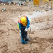 Worker at building lot in working cloths — Stock Photo #5812356