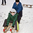 Children are skating at a toboggan run — Stok fotoğraf
