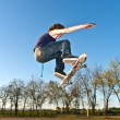 Stok fotoğraf: Boy going airborne with skate board