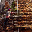 Worker is cleaning surface of famous temple areWat PhrSi — Stock Photo #5815238