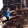 Boy taking picture in famous temple areWat PhrSi Sanphet — Stock Photo #5815274