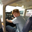 Stock Photo: Joung boy in the pilot seat at the airport