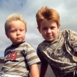 Outdoor portrait of two young brothers in windy weather — Stock Photo #5818320