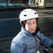 Cute boy in anorak on bike with dirt in the face from riding in — Stock Photo #5818404