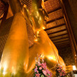 Famous lying buddha in temple Wat Pho in Bangkok — Stock Photo #5818454