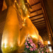 Famous lying buddha in temple Wat Pho in Bangkok — Stock Photo #5818476
