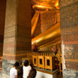 Famous lying buddha in temple Wat Pho in Bangkok - Stock Photo