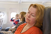 Woman sleeping in the aircraft — Stock Photo
