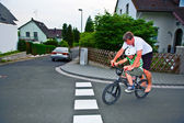 Father and son are riding on one BMX, having fun and enyjoying — Stock Photo