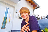 Portrait of boy in front of the house — Stock Photo