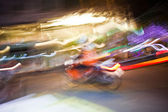 Motobike driver by night with abstract lights — Stockfoto