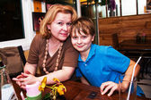 Boy sitting with his mother in a restaurant — Stock Photo