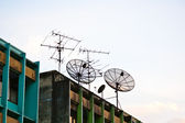 Antenna and satellite on a roof in bangkok — Stock Photo