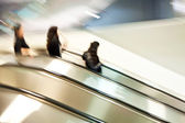 On a moving staircase — Stock Photo