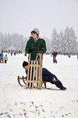 Children are skating at a toboggan run — Stock Photo