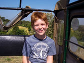 Boy with red hair in the jeep in enjoying the safari — Stock Photo