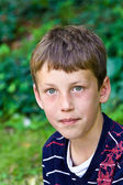 Portrait of a friendly seriously looking young boy — Stock Photo