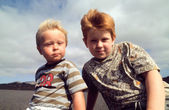 Outdoor portrait of two young brothers in windy weather — Stock Photo