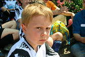 Boy is looking angry and disappointed from soccer playing — Stock Photo