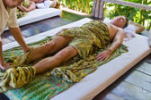 European man gets a healthy massage in thailand and enjoys it — Stock Photo