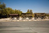 Old original wooden stage coaches in a Ranch in Desert Valley — Stock Photo