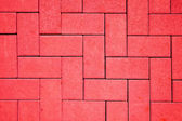 Pavement pattern made with cast concrete blocks in red color — Stock Photo