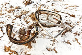 Littered and rusty bicycle as trash on snow — Stock Photo