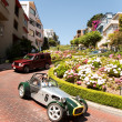 Stock Photo: Oldtimer passing lombard street, sFrancisco