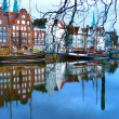 Beautiful view to the TRAVE in Luebeck with reflections in the harbor — ストック写真